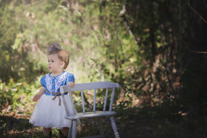 everly turns one | baby girl outside holding on to an antique chair {tallahassee child photographer}