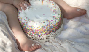 everly turns one | baby sitting down with her first cake in front of her {30a child photographer}