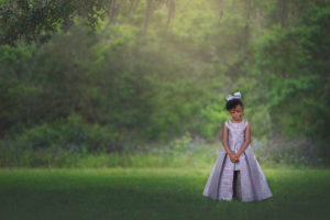 a perfect miracle | little girl amongst the oak trees in a silver dress with a silver bow {watercolor, florida child photographer}